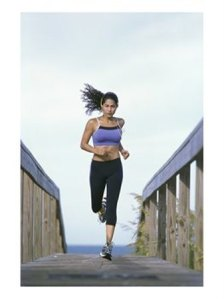 superstock_1098r-6279ayoung-woman-running-with-headphones-posters1