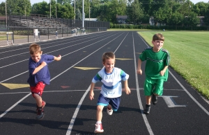 bigstockphoto_Kids_Running_on_Track_781902[1]